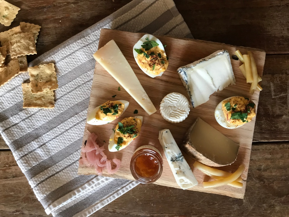 cheese board with deviled eggs